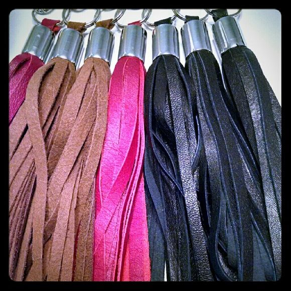 Leather tassel RED silver hrdwre Add more glance to your favorite purse,wallets,clutch,and key rings with this 100% leather  tassels available  in gold and silver hardware  NWOT more colors available  please check my listing. *price each* H&M Bags