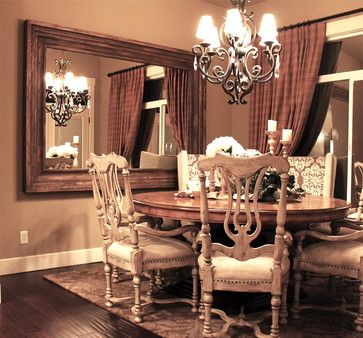 Large Wood Framed Mirror Mounted On The Dining Room Wall
