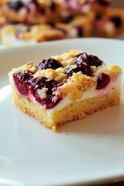 Photo of Cherry crumble cake from a tin with curd cheese –
