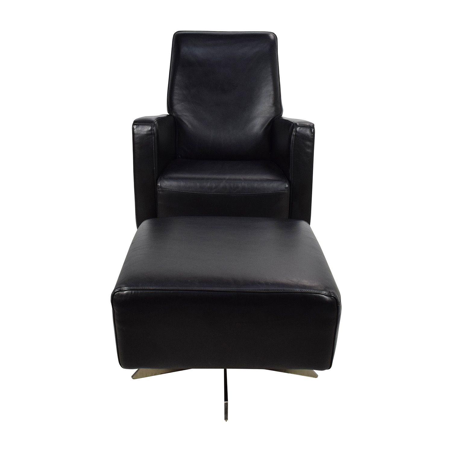 Natuzzi black leather swivel chair with ottoman with