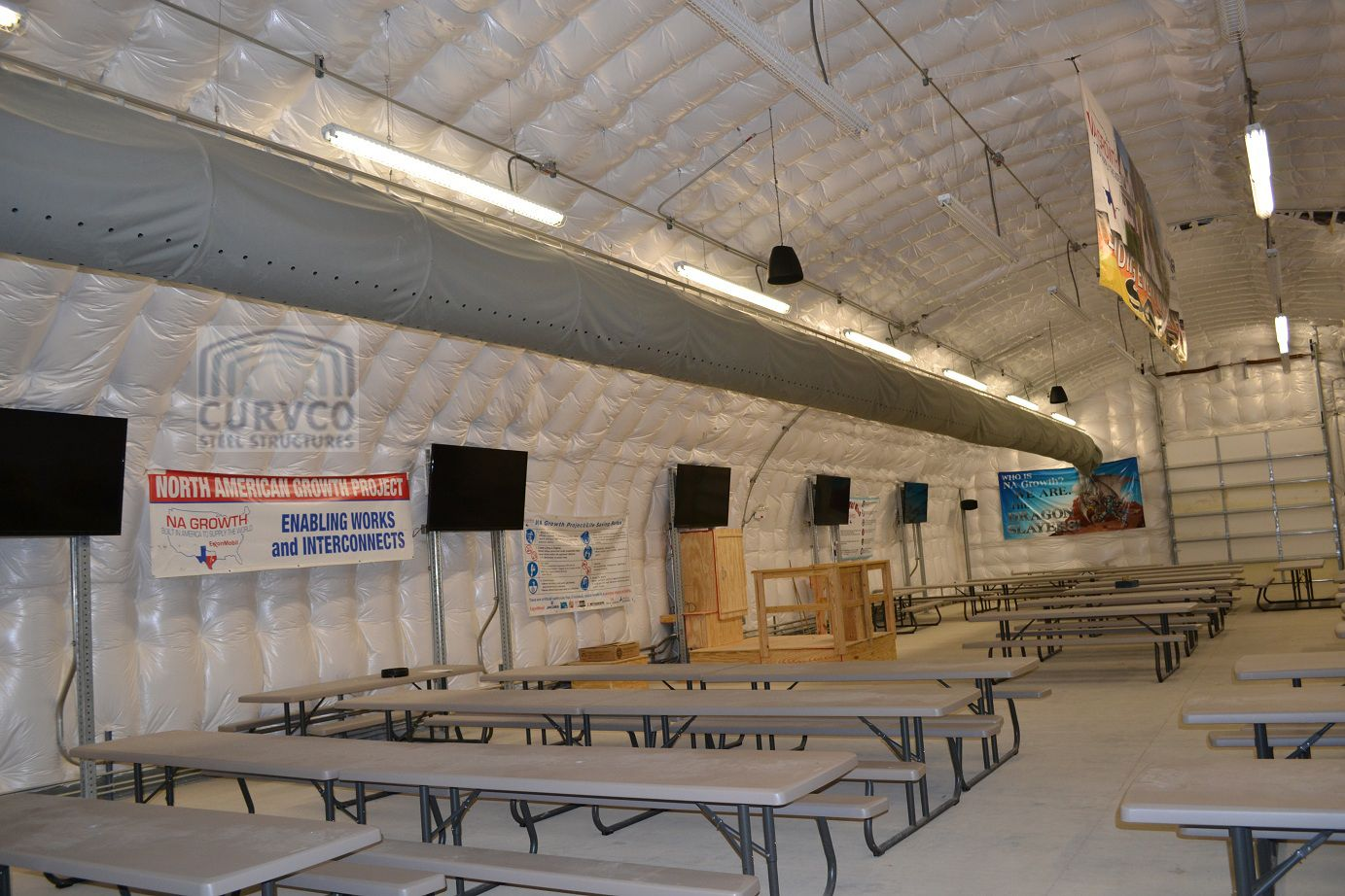 Arch Steel Buildings are most often insulated using