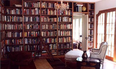 Home library with built in wood bookshelves
