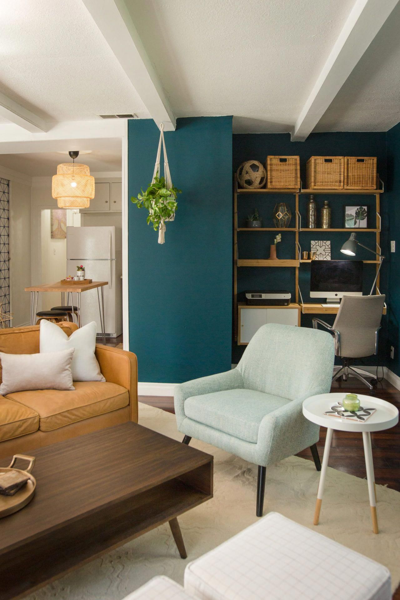 The Shades Of Green And Teal Play Off Of Mixed Wood Tones And A Leather Sofa To Make A Color P Teal Sofa Living Room Living Room Green Yellow Decor Living #teal #sofa #living #room #decor