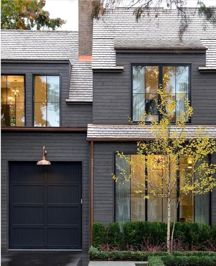 Charcoal Gray Exterior With Copper Gutters And Light