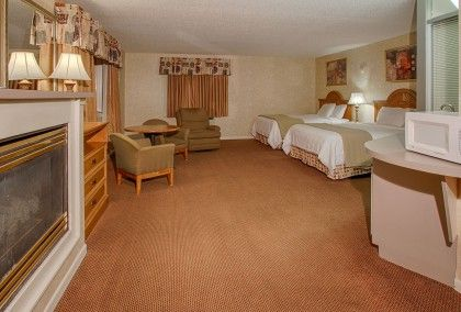 A Pigeon Forge Hotel Suite With A Romantic Fireplace A Small