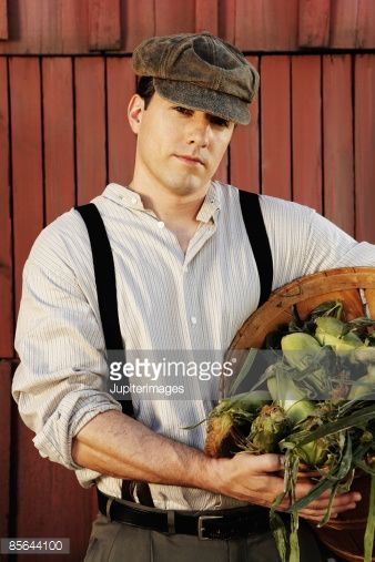 Stock Photo : Man in old-fashioned clothing with bushel of corn