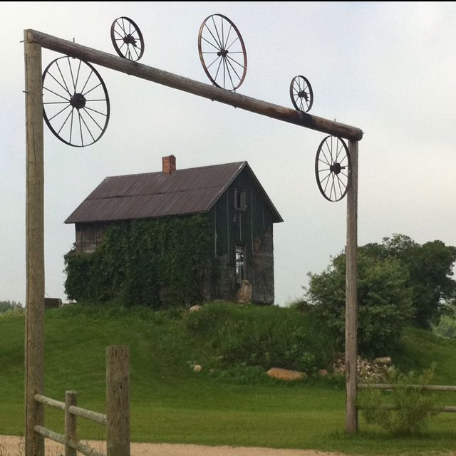 Wagon Wheel Arch And Abandoned House In Northern Michigan