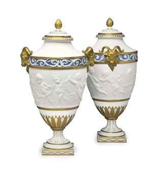 A PAIR OF SEVRES STYLE BISCUIT PORCELAIN VASES AND COVERS, 19th c.