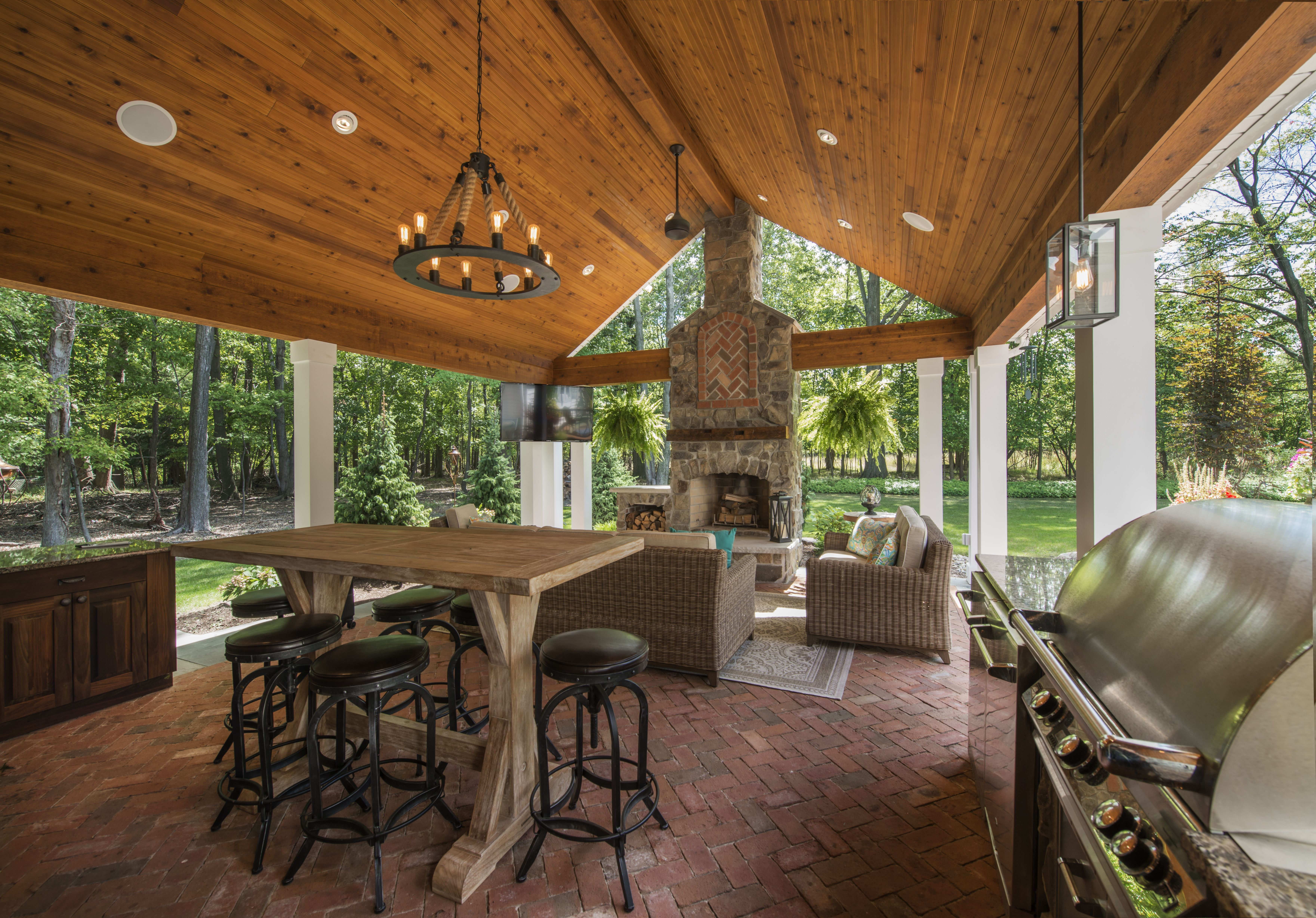 stunning rustic outdoor living space complete with fireplace grill outdoor kitchen and ample on outdoor kitchen on deck id=78509