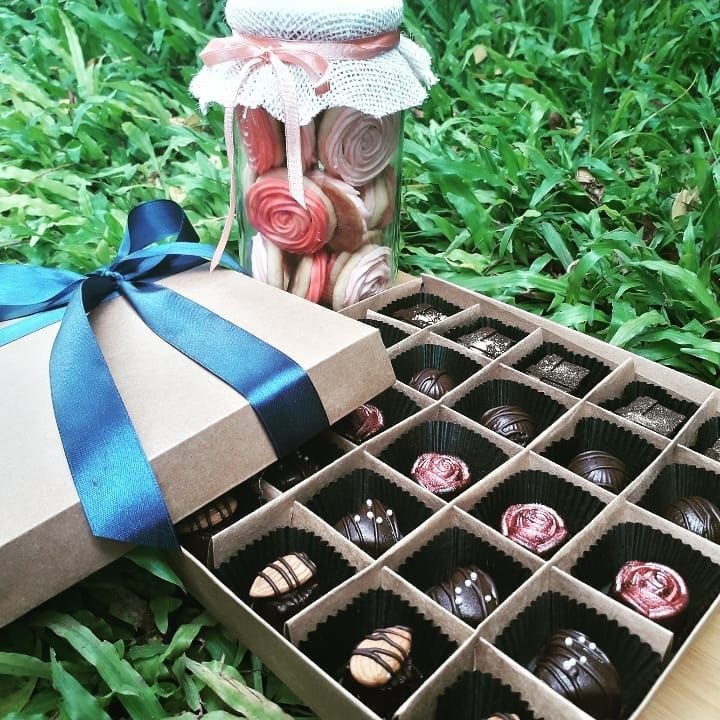 Customized gift packs . Send some love with a jar of cookies and a box of chocolates . .