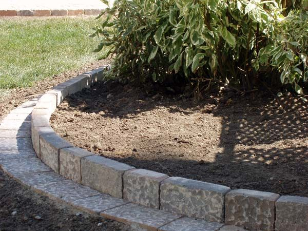 Paver edge this is what we need to do to the front garden for Brick edging for your flower beds