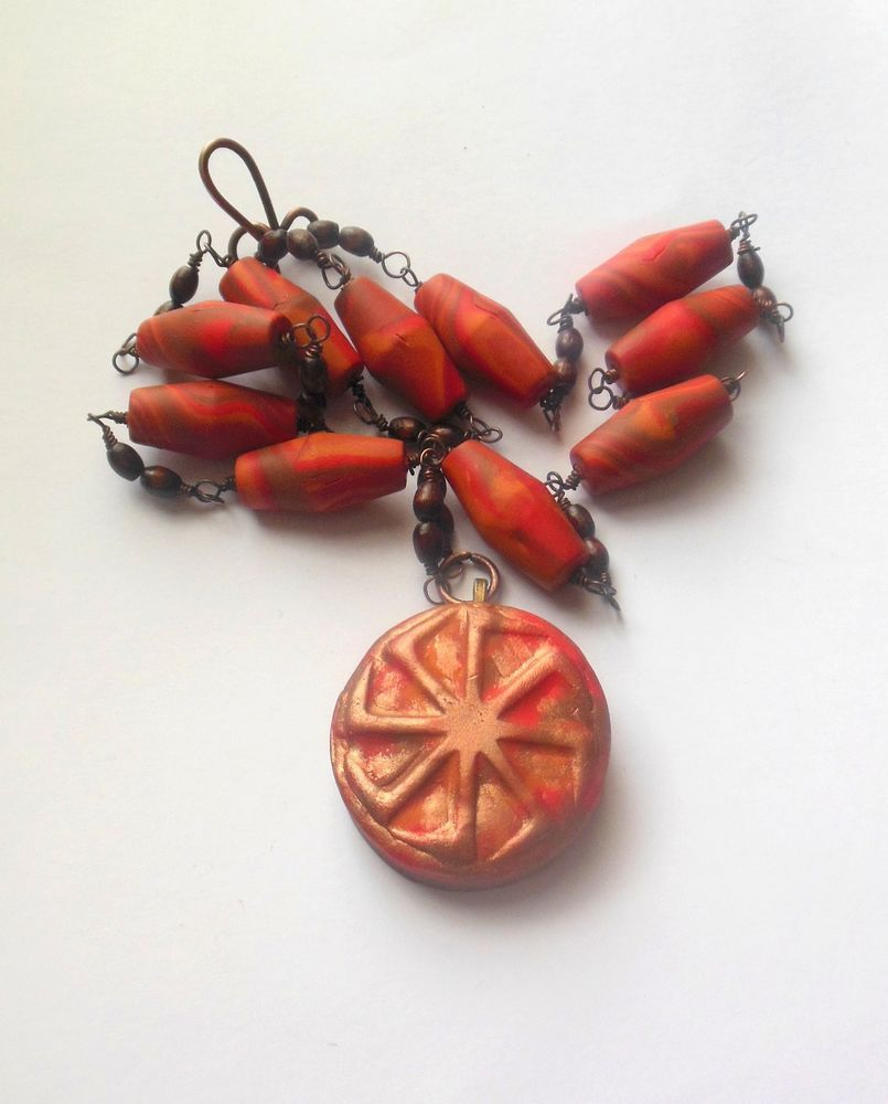 Polymer clay orange, red colour necklace with Kolovrat pendant.