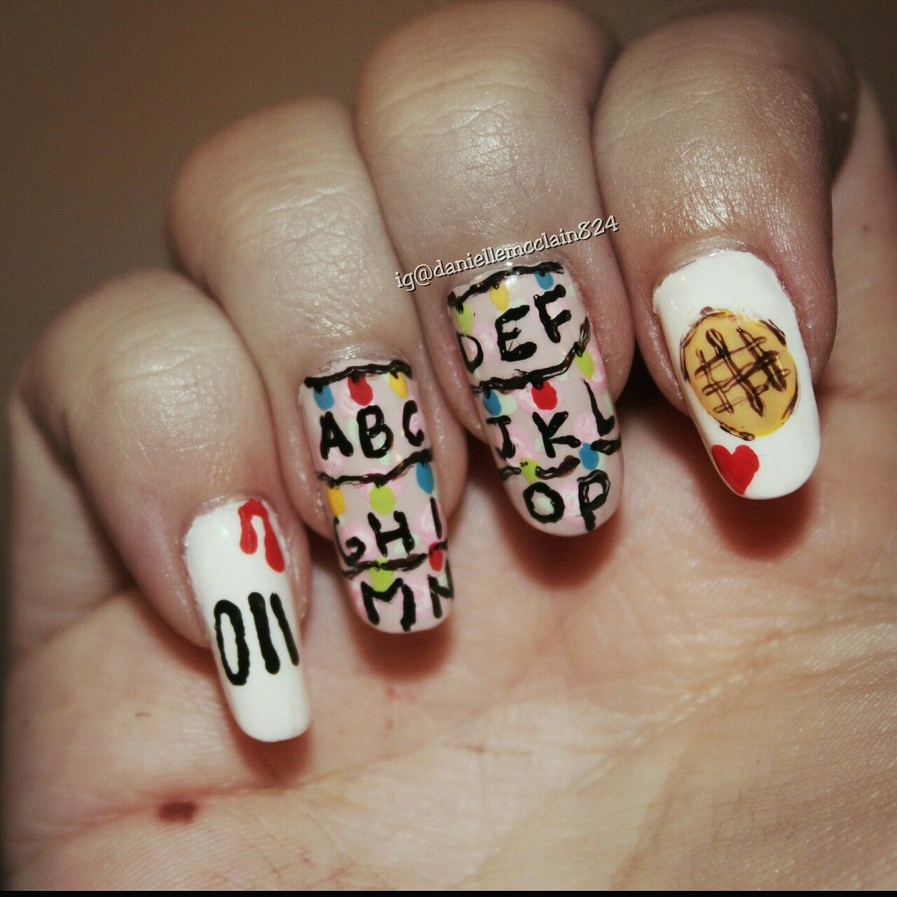 stranger things Netflix tv show themed nail art with some eggo ...