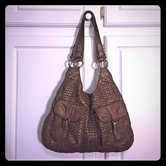 Linea Pelle large leather hobo Genuine leather hobo. The color is a caramel with a metallic finish. Super soft! Still plenty of life left in this beauty!  Reasonable offers are welcome! Linea Pelle Bags Hobos