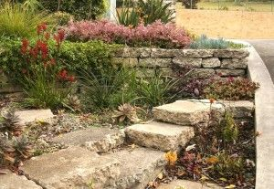 dry stack broken concrete retaining wall - great way to reuse our neighbor's old patio