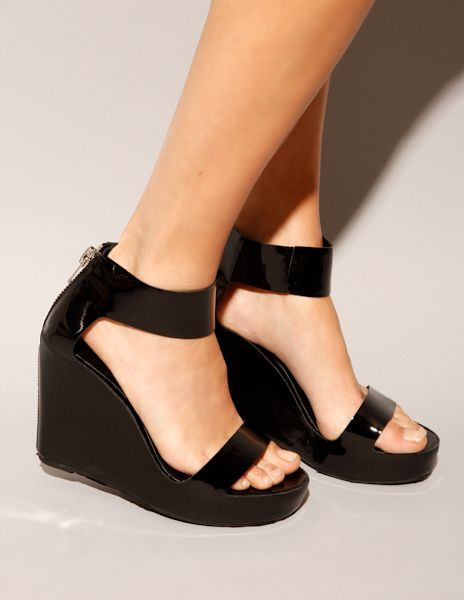 5cd3e6343b6 Classic staple black patent leather wedges with ankle strap and exposed  back zipper along shoes spine. Runs