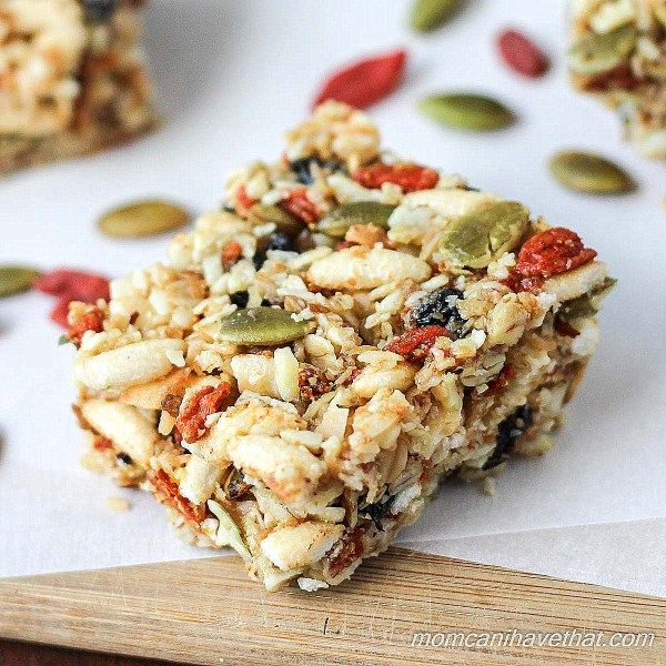 Gluten-free oats, nuts, & seeds make the base for these lightly - sweetened Kitchen Sink Snack Bars healthy - currents, puffed rice & gogi berries make them fun.
