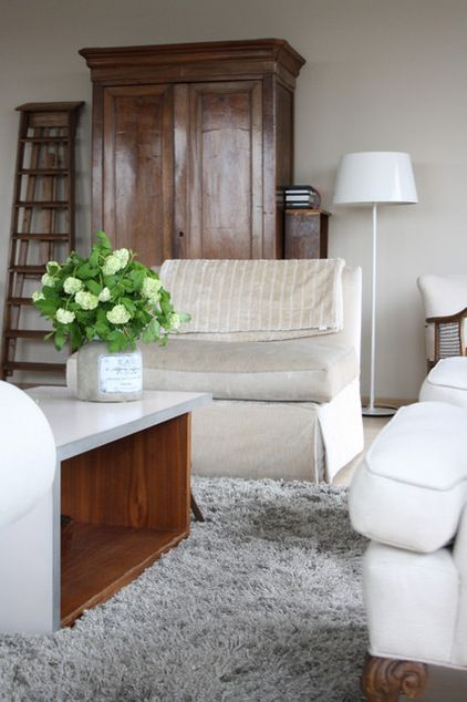 contemporary living room by Holly Marder. ONE LARGE PIECE, LIKE THE ARMOIRE IN THE LIVING ROOM, ANCHORS A room