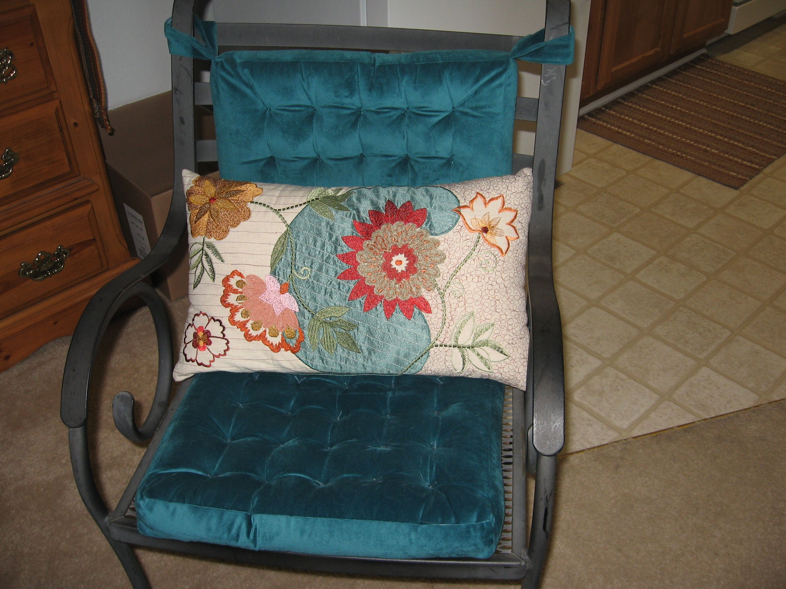 Turn your outdoor furniture into indoor furniture by adding cushions and a throw pillow.