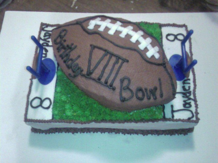 8th bday cakd for a football fan.  Texture on football was done by rubbing a dotted papertowel on icing once it was dry.