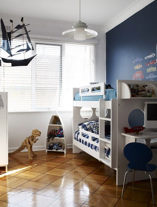 Navy denim blue feature wall with vintage car decals by for Denim bedroom ideas