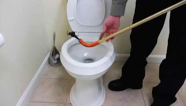 How To Clear A Clogged Toilet With A Closet Auger Howcast Clogged Toilet Toilet How To Unclog Toilet