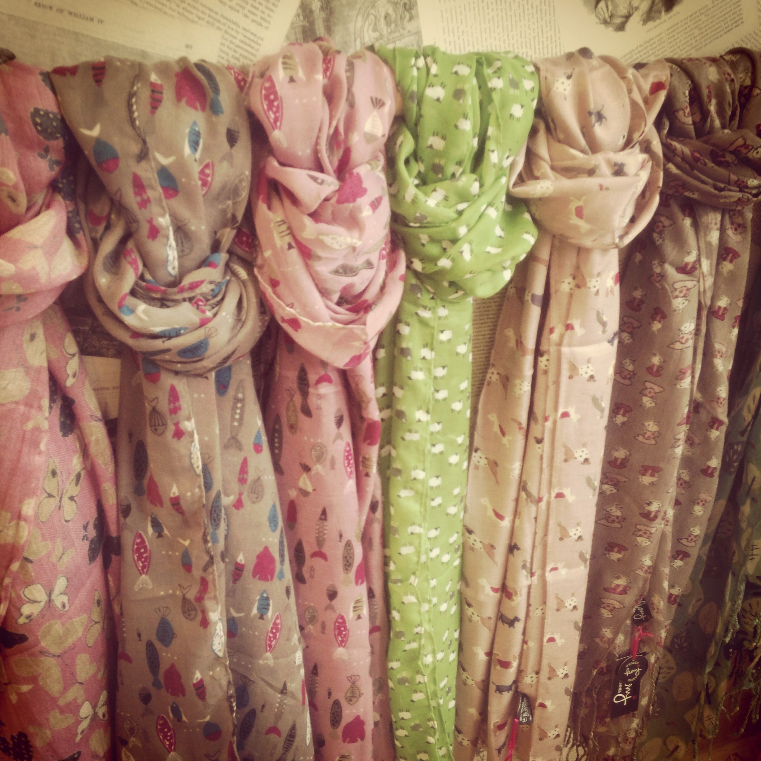 Our wonderful scarves available in store.x