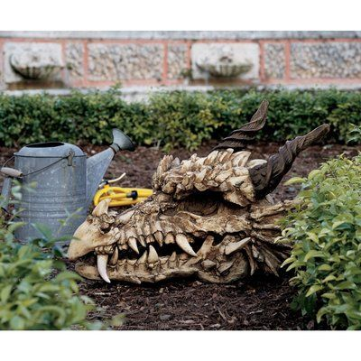 Design Toscano This large-scale statue for your home or garden is guaranteed to impress friend and foe with its sheer magnitude and detail. It is cast in quality designer resin and finished to be indistinguishable from authentic fossils.