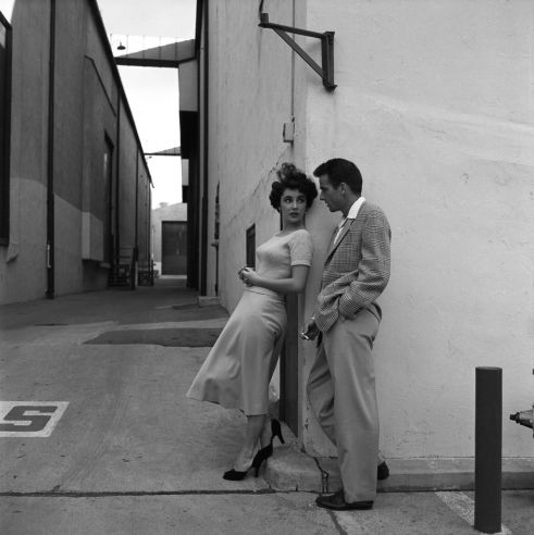 Unpublished. During a break in filming A Place in the Sun, Taylor chats with her costar Montgomery Clift on the Paramount lot in 1950. The two would remain close friends; she would even save his life in 1956, after he smashed his car into a telephone pole following a party at her house. (Taylor removed his shattered teeth from his throat, and kept him from choking).