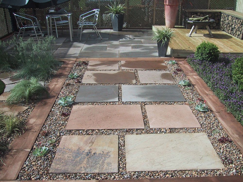 Stepping stones in gravel, patio area and raised deck with ... on Stepping Stone Patio Ideas  id=31862
