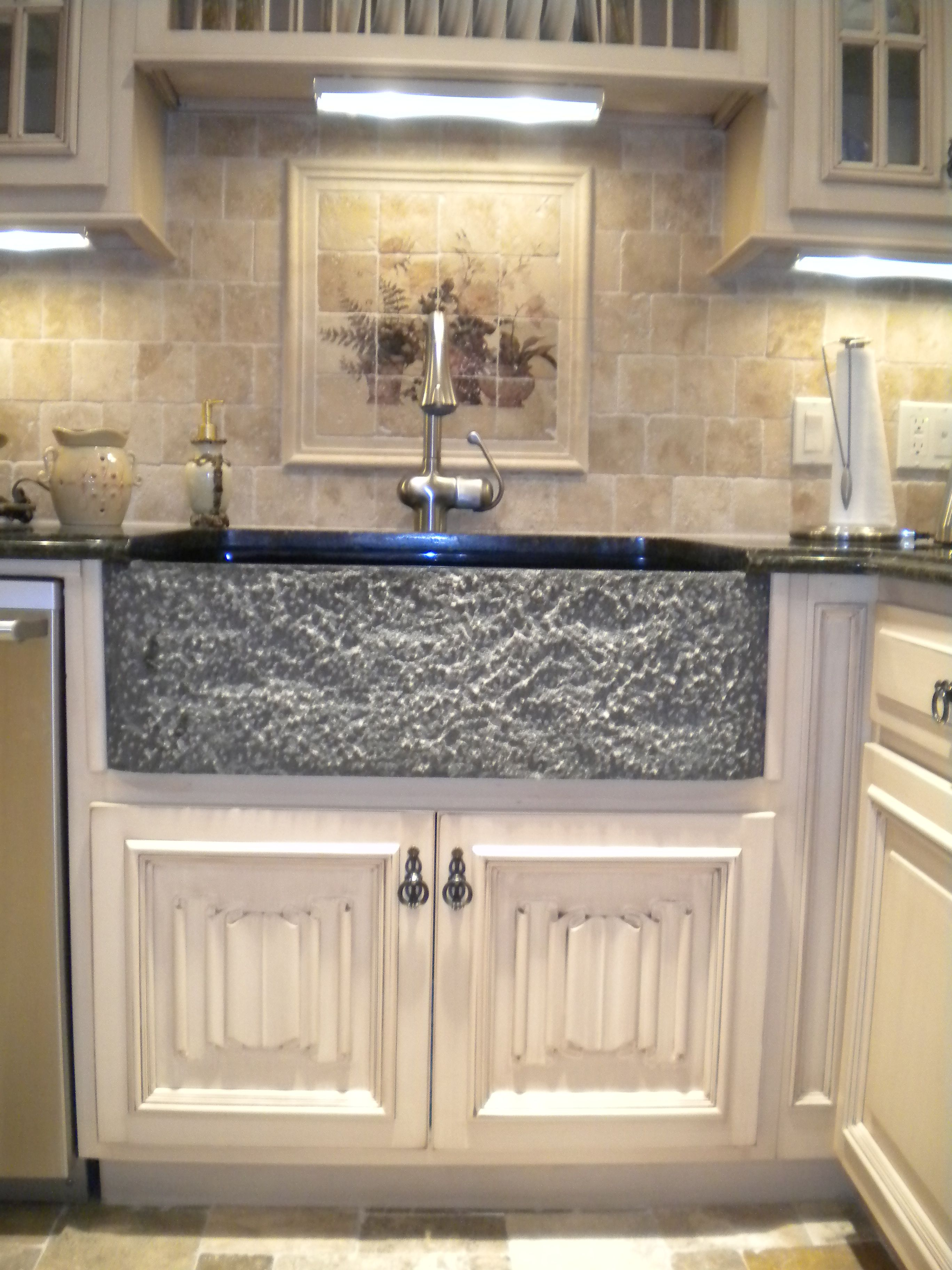 Solid granite farmhouse sink with Linen Fold Doors on the