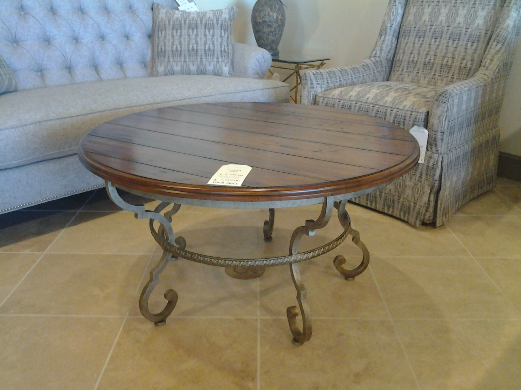 Round cocktail table with metal base made by Century Furniture