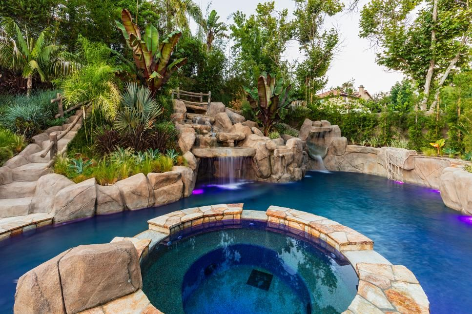 Tropical Backyard With Water Slide, Caves for Exploring