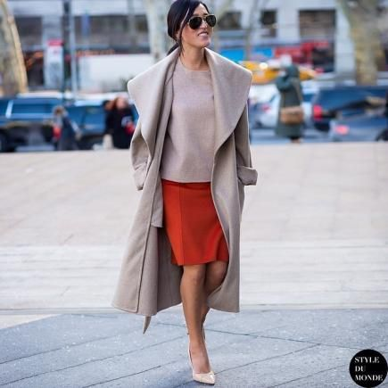 Neutral outfits were one of the most prevalent trends on the NYC sidewalks during Fashion Week, but leave it to Nicole Warne to put her own colorful spin on the style with a bright skirt. #FashionWeek #StreetStyle