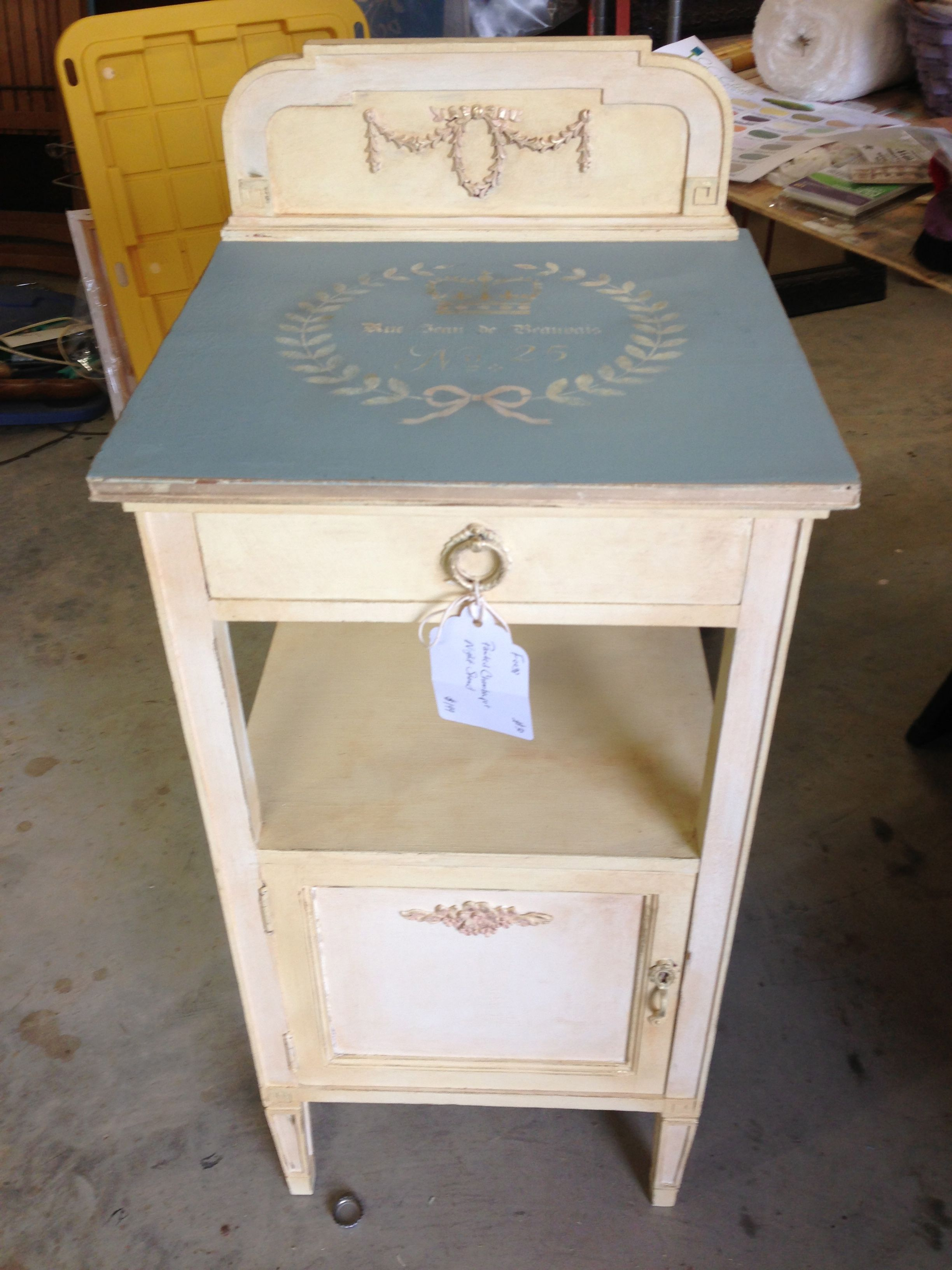 A sweet little side table painted with CeCe Caldwell's Paints in Johnston Daffodil and Chesapeake Blue. Facebook; Vintage Fresh Studio
