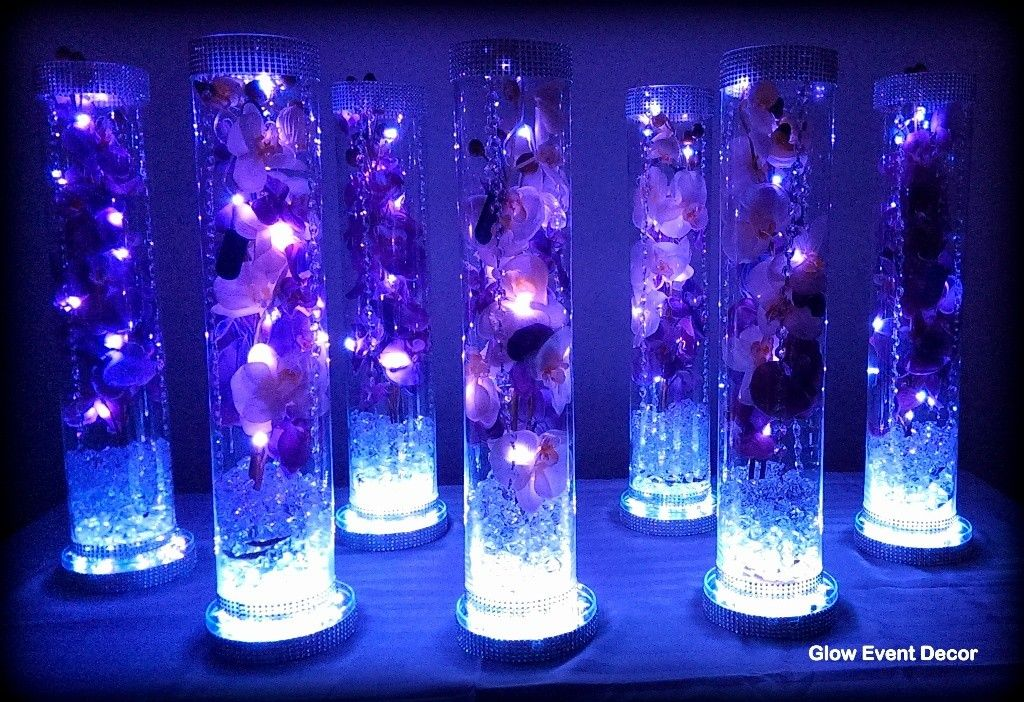 Cylinder vase with purple orchids wedding table for Lighted wedding centerpieces ideas