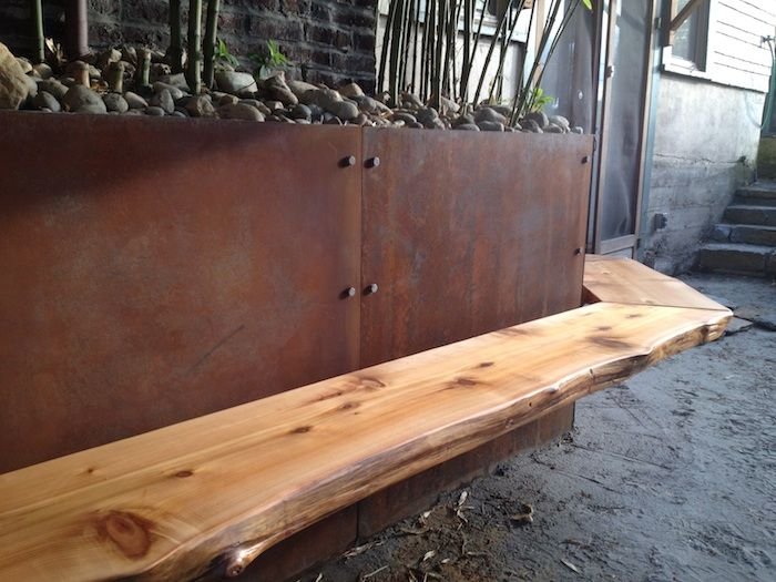 Steel plate retaining wall/bamboo containment, live-edge cedar bench