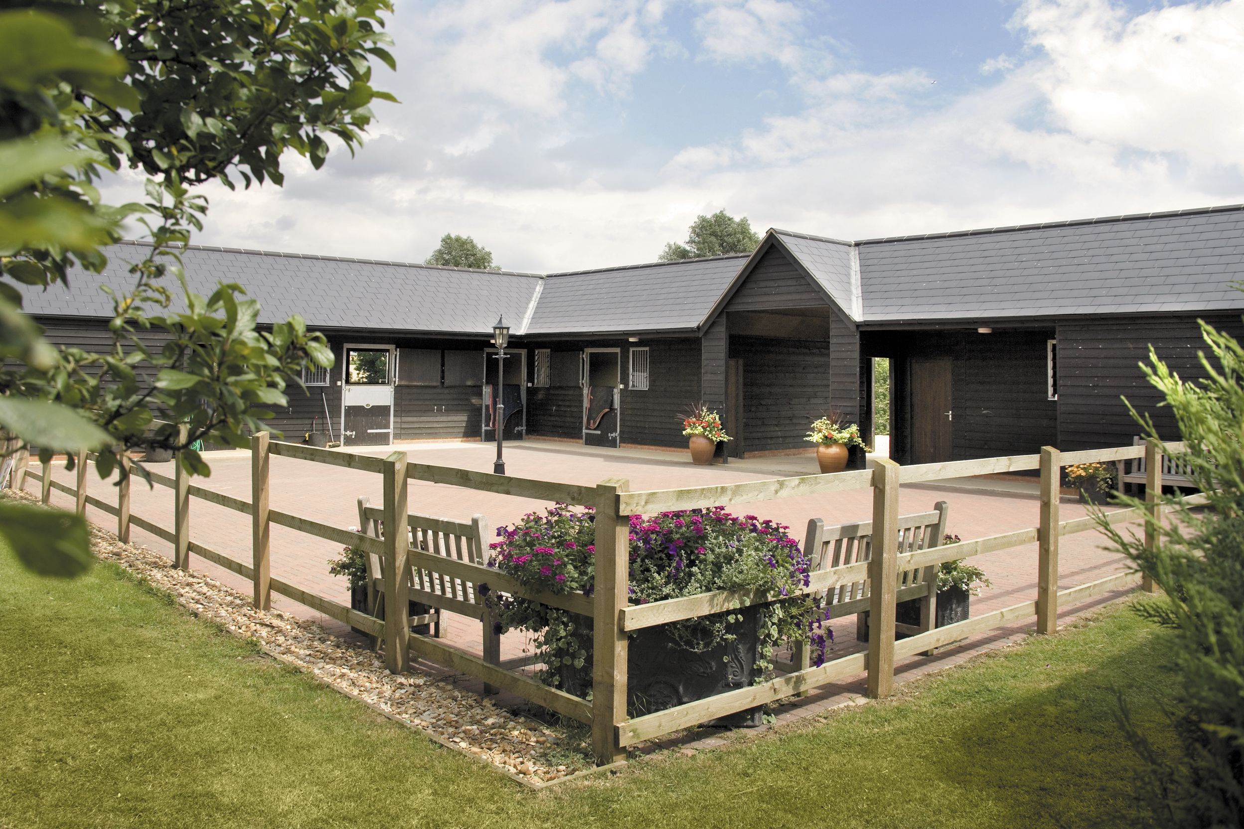 L shaped yard designed to blend in with the surrounding for L shaped shed designs