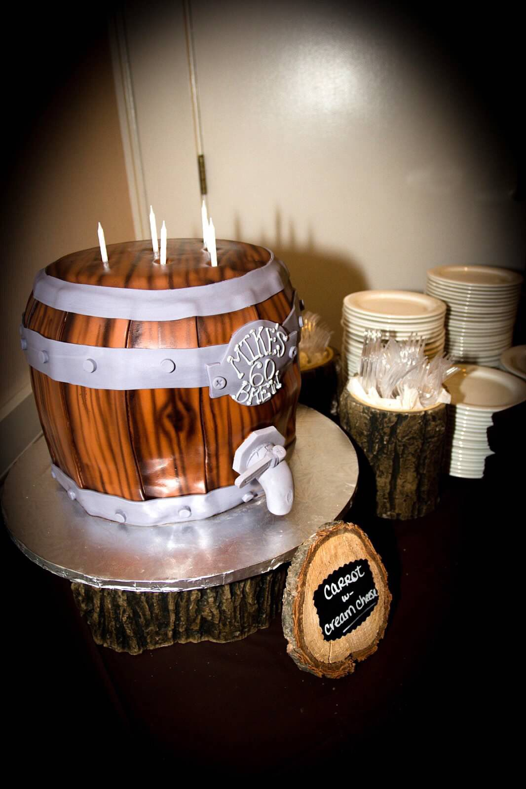 Beer barrel cake. Rustic 60th birthday party: Posh n' Chic Prints was the event planner