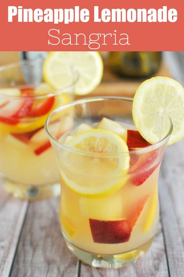 Pineapple Lemonade Sangria – the ultimate summer drink recipe! White wine, lemonade, and rum with tons of fresh fruit mixed in. It can be made ahead so it is perfect if you are prepping for a party! #pineapplelemonade
