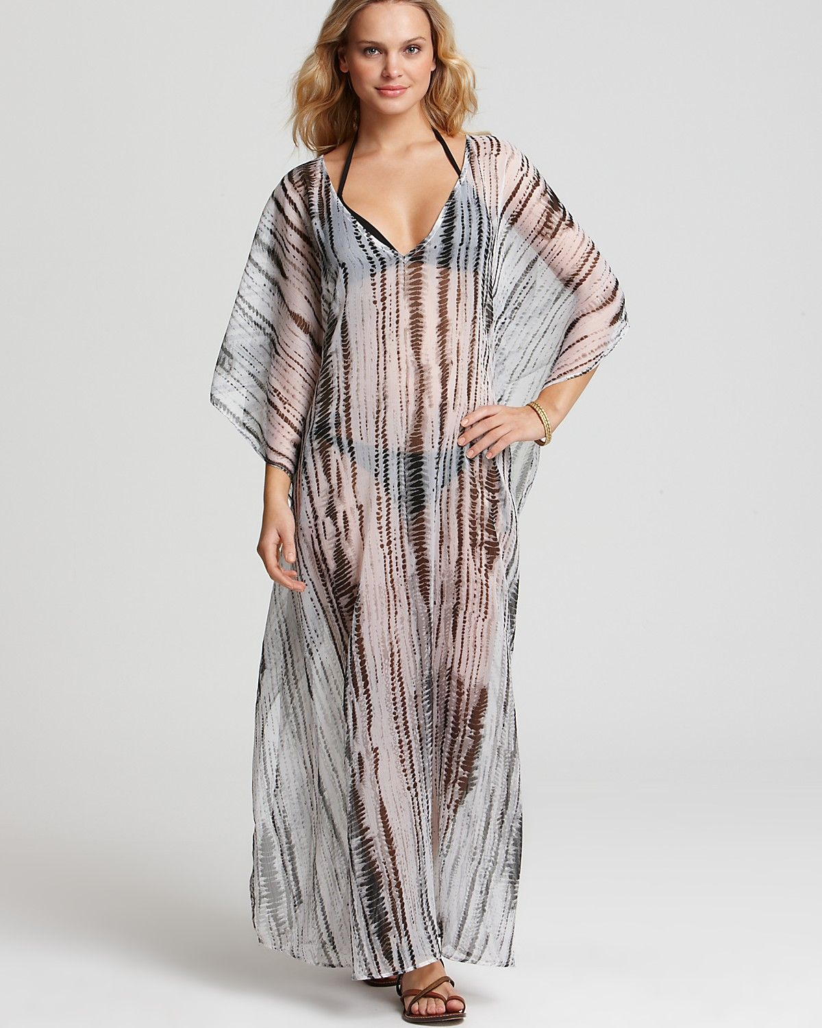 3622c37b43 If your swimsuit is solid black, try this black and white long caftan sheer  coverup from Echo Ikat (at Bloomingdales) for a dramatic look.