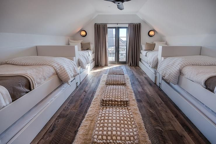 Chic Sleepover Room Features Two Rows Of Built In Twin