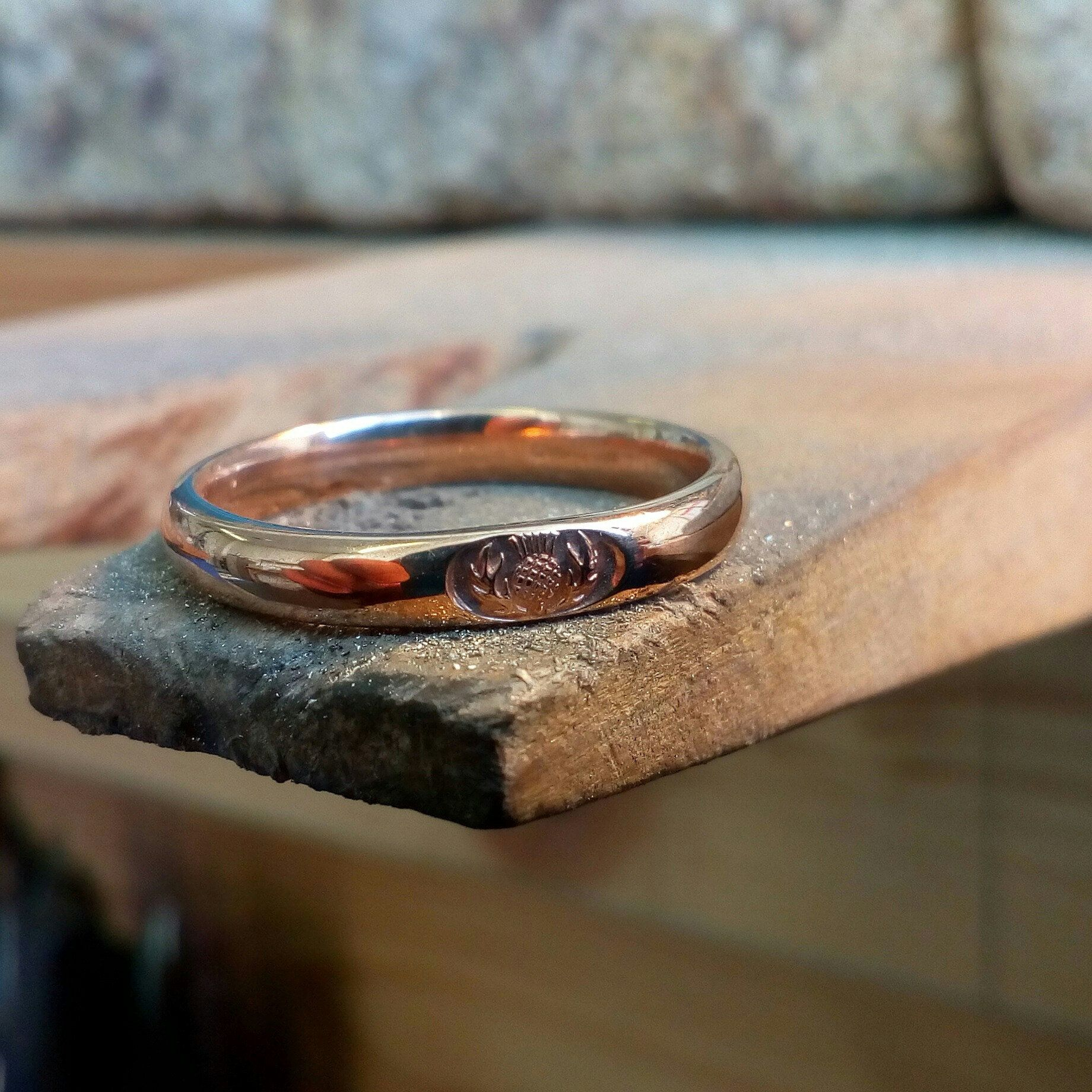 It is just a picture of Love rose gold. This is my narrow Scottish Thistle wedding band