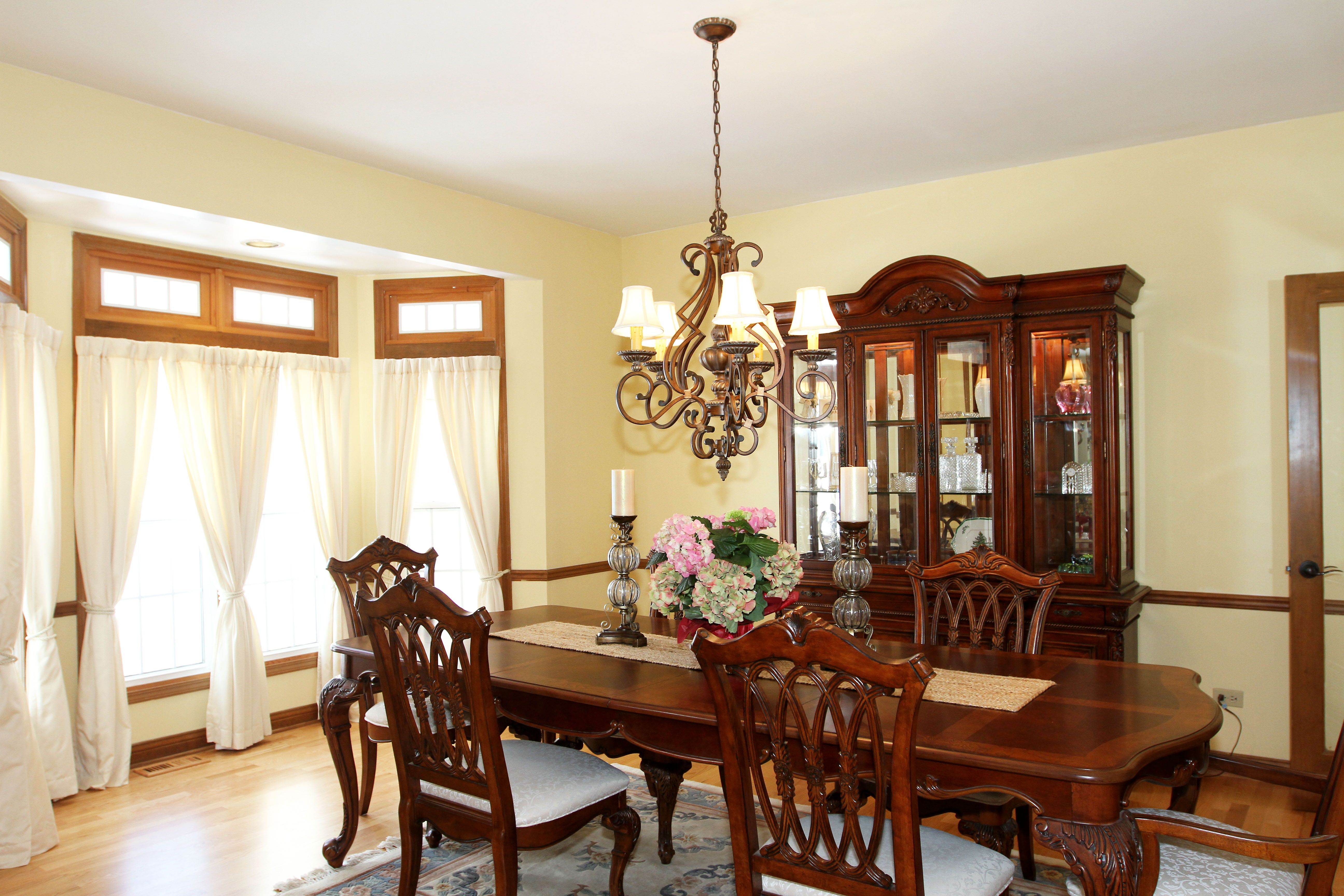 Center entry is flanked by formal living and dining rooms The
