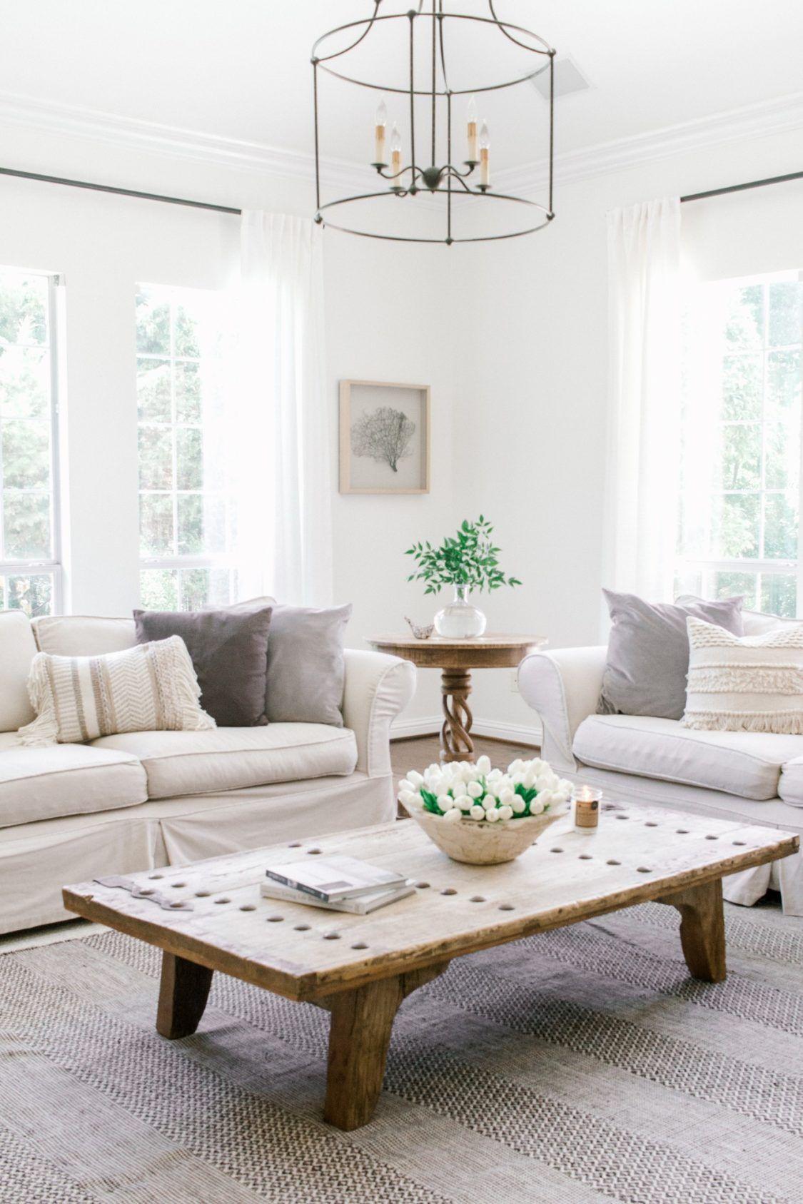 A coastal farmhouse in white done so right room decor