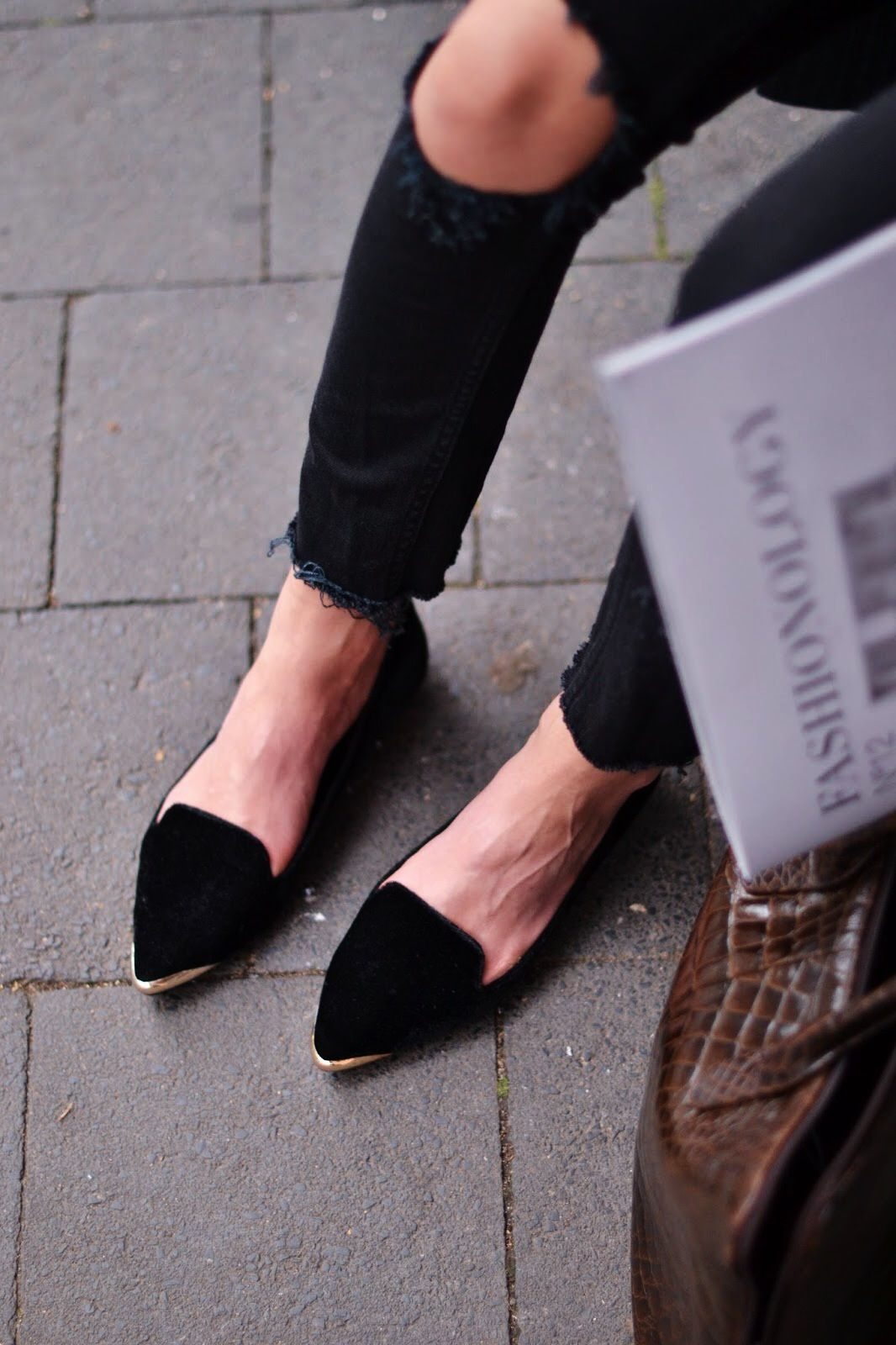 As always, we adore the high-low combo of torn jeans and posh flats.