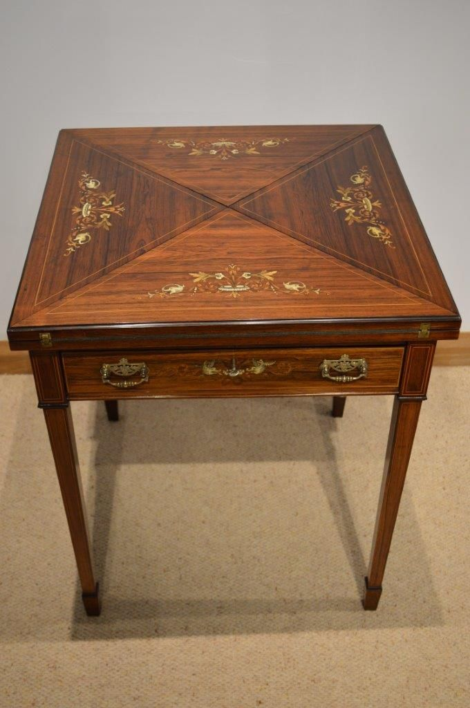 A Beautiful Late Victorian Period Rosewood And Marquetry Inlaid Envelope Card Games Table