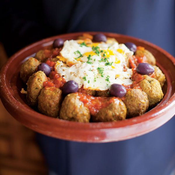 Cumin and paprika-spiced lamb meatballs are baked in a fragrant tomato sauce in this elegant tagine from Moroccan restaurant Le Timgad in Paris.