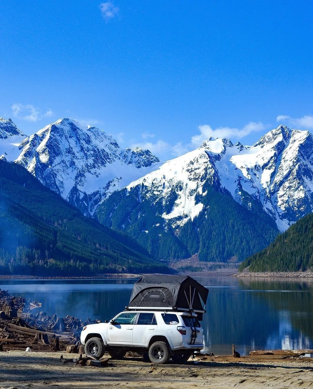 Beautiful Camping Spot On The Lake In This Winter Wonderland Surrounded By The Snowy Mountains With This Aw Camping Spots Snowy Mountains Camping Photo