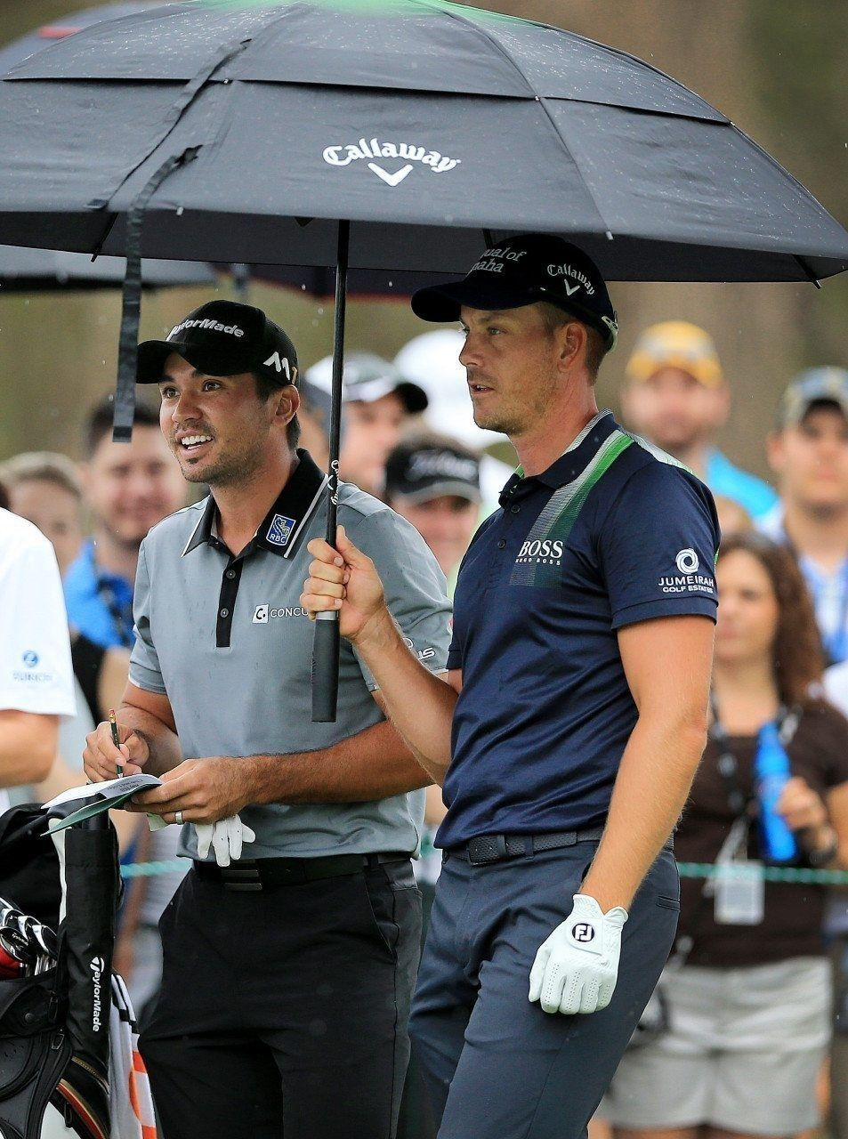 2016 - Jason Day and Henrik Stenson take cover under an umbrella on Saturday during the Arnold Palmer Invitational at Bay Hill Club and Lodge.